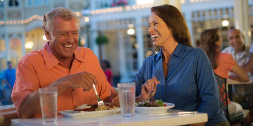 Couple enjoying the International Food and Wine Festival at Disney World