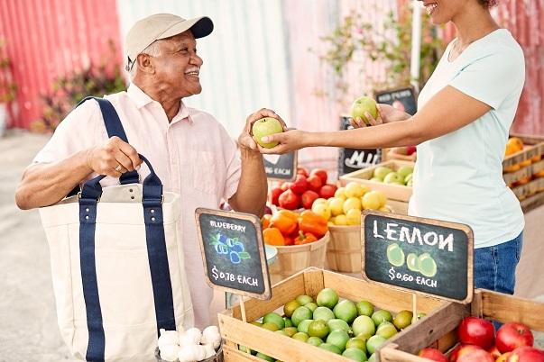 man buying produce at the market